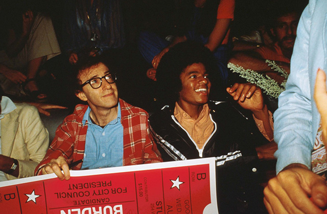 Woody Allen and Michael Jackson sit together at Studio 54 April, 1977 in New York City