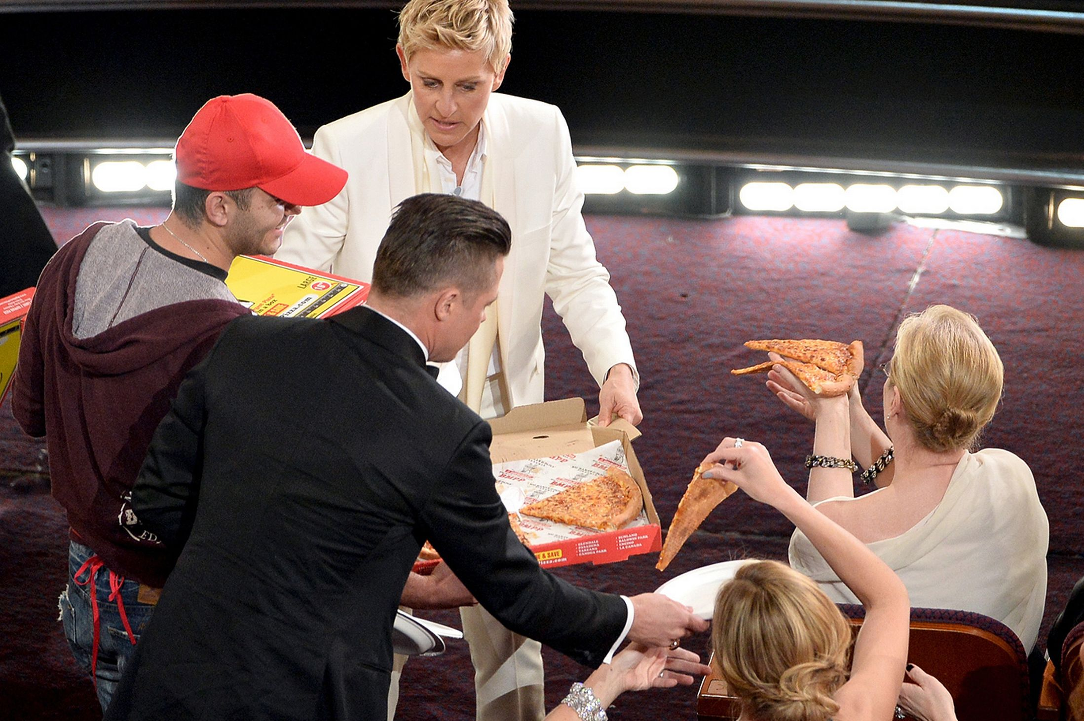 Ellen-DeGeneres-with-pizza-delivery-man_Getty