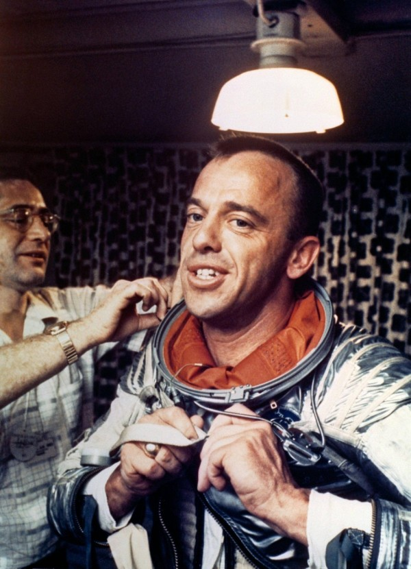 Alan Shepard, America s first man in space, puts on his Navy Mark IV spacesuit.
