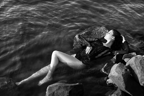 Beautiful Girl Laying on the Rock by River